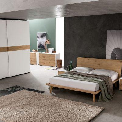 camere-moderne-design-legno-laminato-armadi-battente-scorrevole-letto-pannello-imbottito (10)